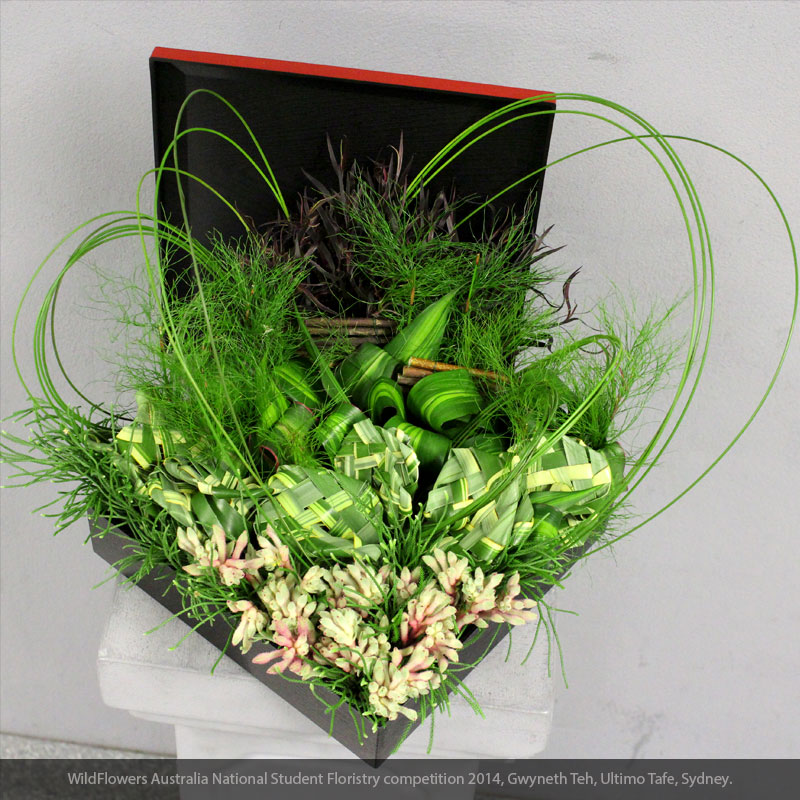 Flexi grass and Dingo fern are used in this creative floral design.