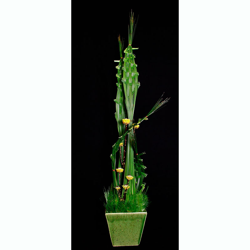 Upright floral design using steel grass woven
