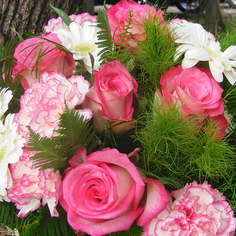Native ferns and grasses mix beautifully with roses and carnations