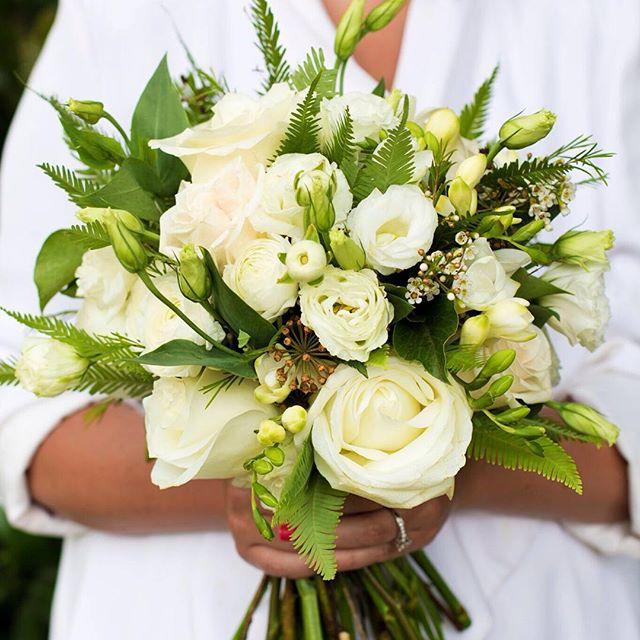 White bouquet featuring umbrella fern