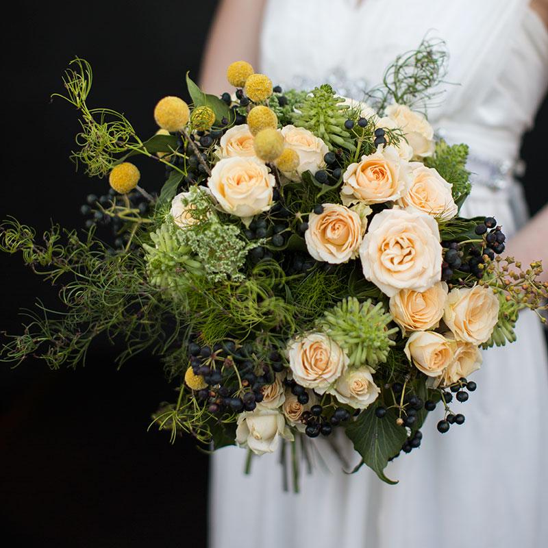 Goanna Claw enhances the unique elegance in this warm lemon coloured bouquet.