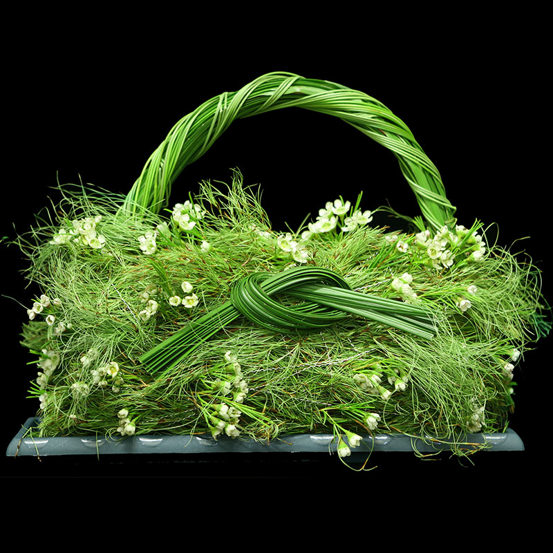 Basket created using flexi grass, emu feather, koala fern and waxflower.
