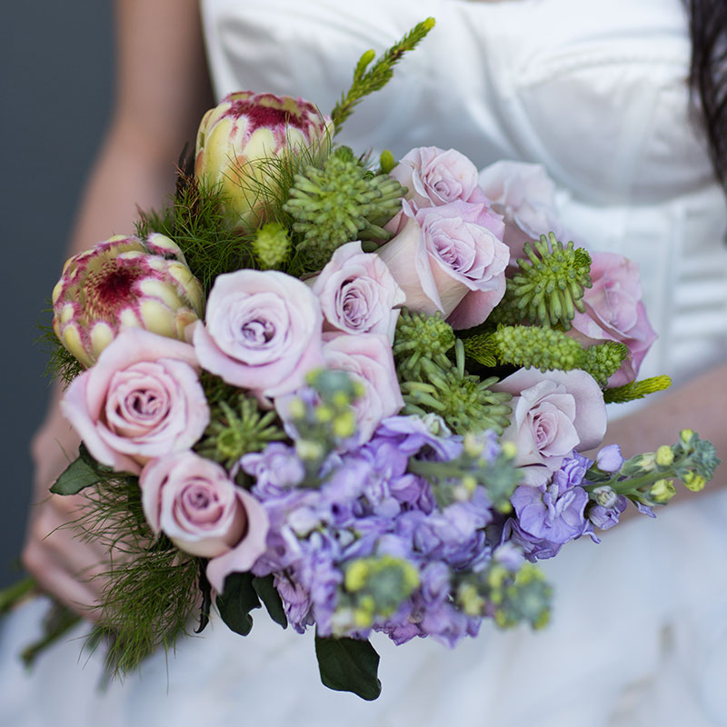 Tufts of Koala Fern gently soften this lilac inspired bridal bouquet.