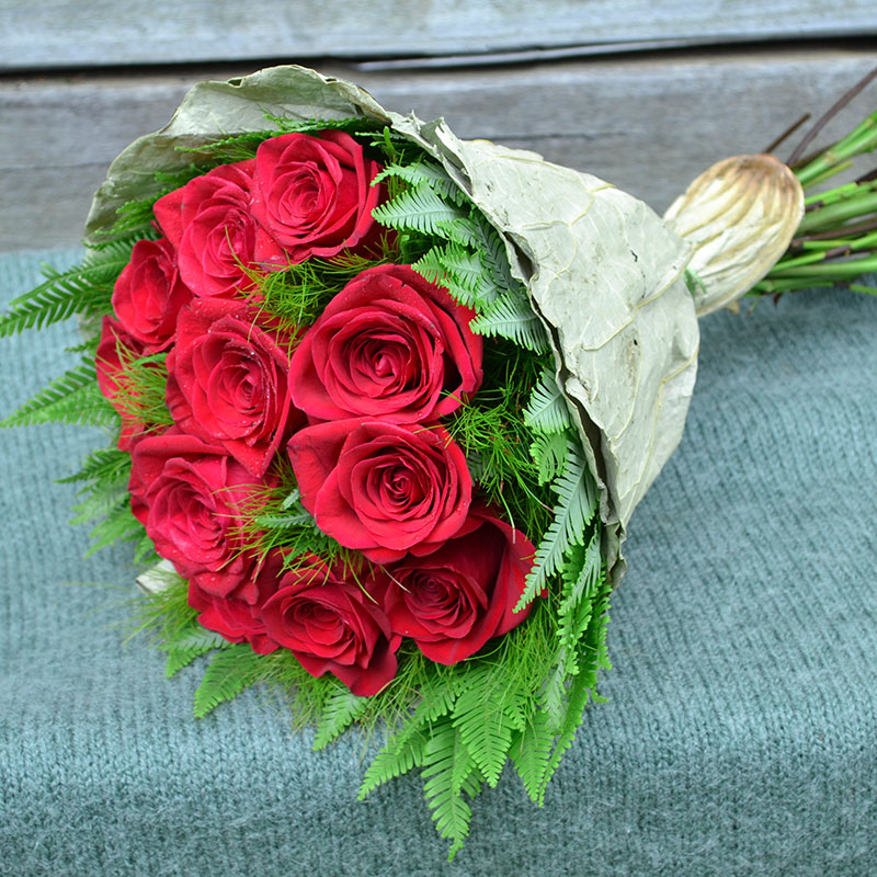 Bouquet of red roses, Umbrella and Koala Fern