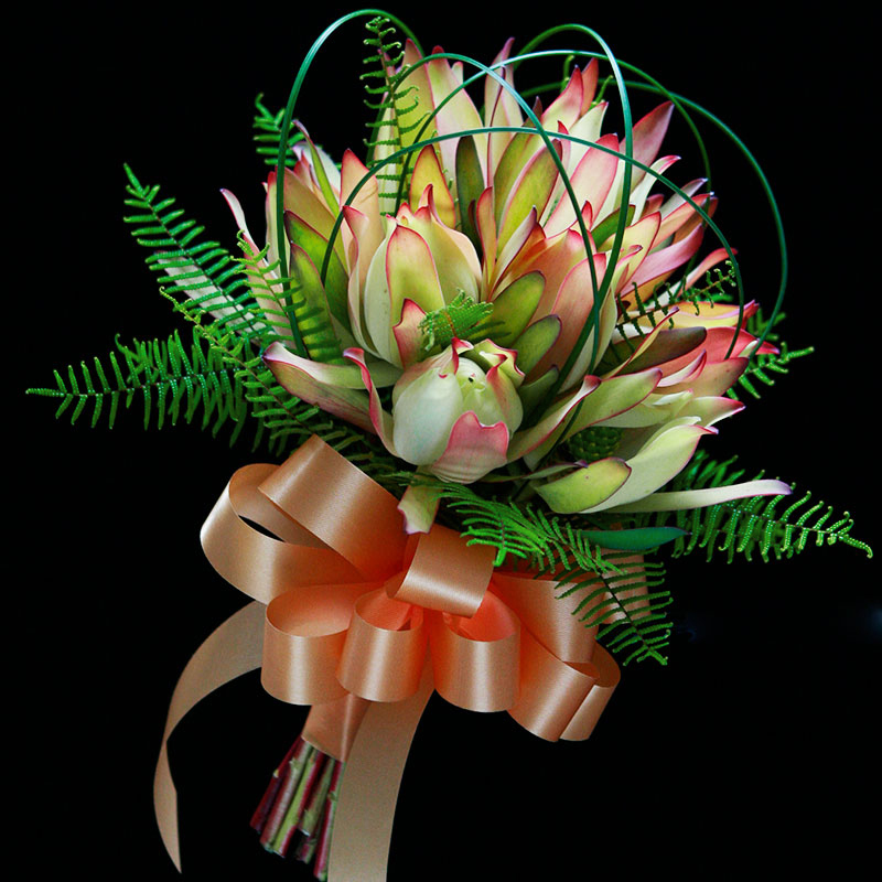 Sea star fern and steel grass feature in this bouquet