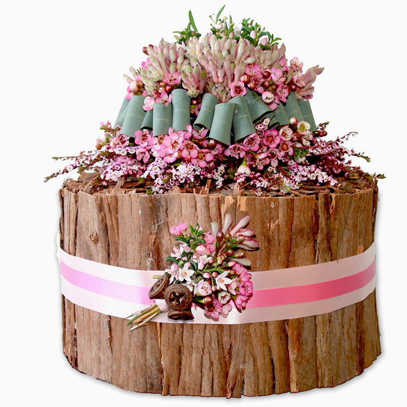 Waxflower and thryptomene feature in a rustic Aussie design.