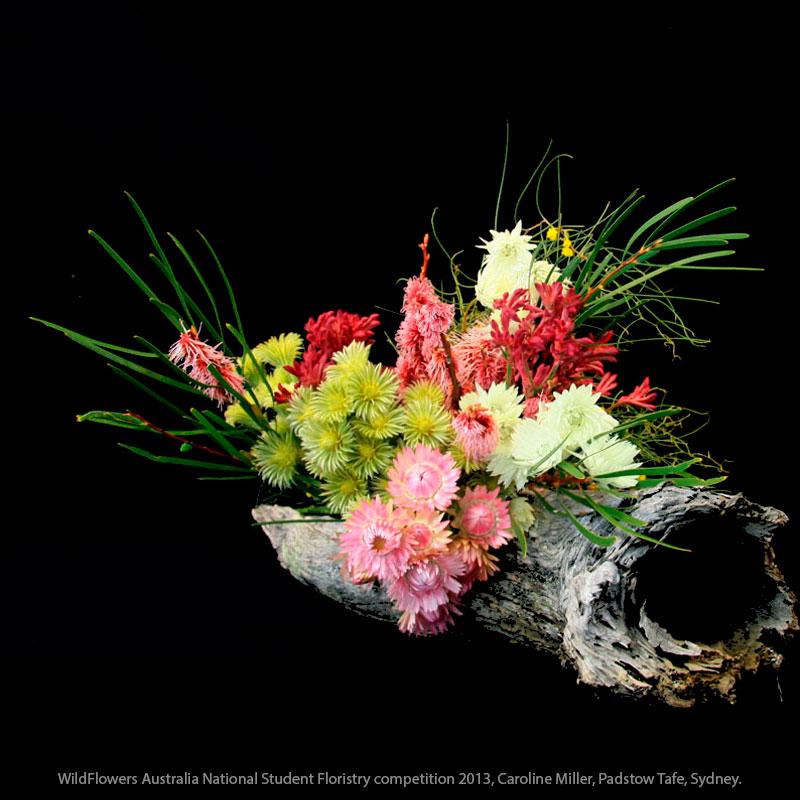 Barker Bush arrangement, log used as a vase.