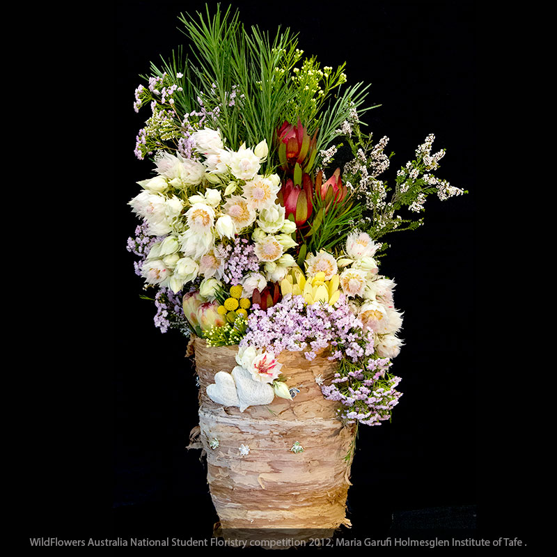 Emu grass, waxflower and thryptomene feature in this rustic floral design