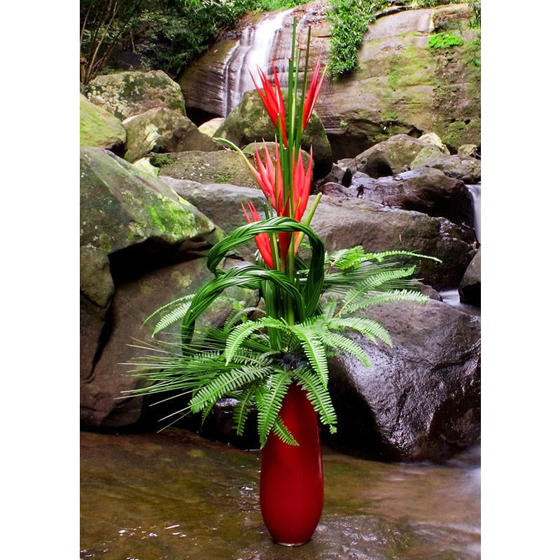 Plantation Umbrella Fern and Steel Grass are used in a stunning floral design set beneath a waterfall.