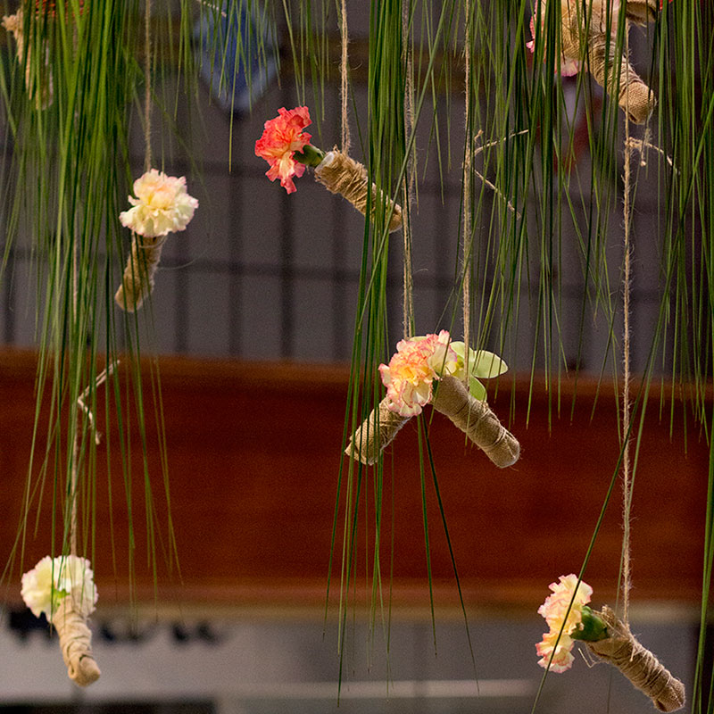 Hanging Steel Grass and carnations used for floral design installation