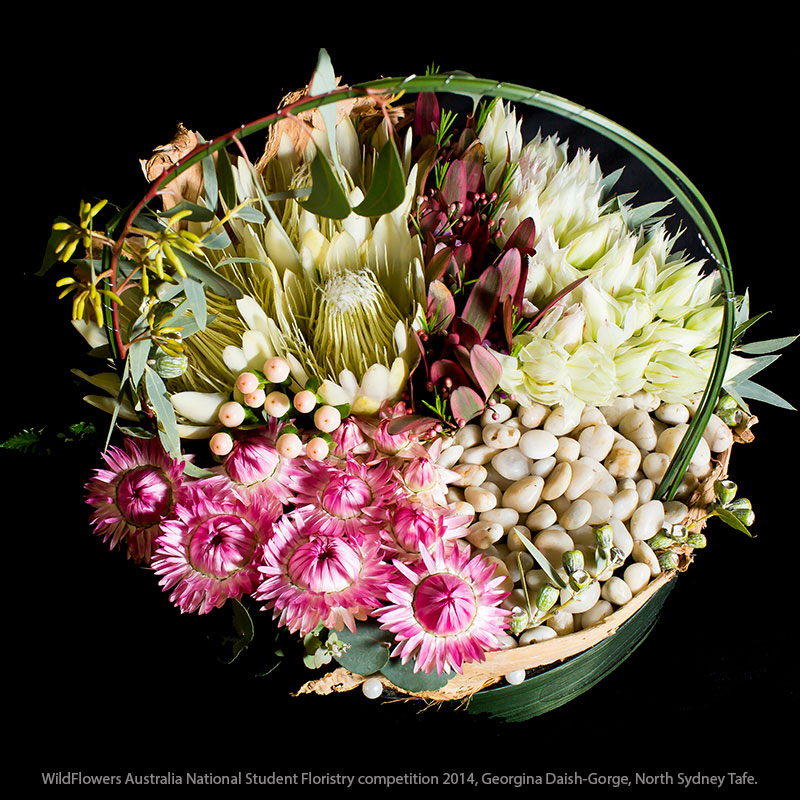 Steel grass is used to accent the curved style of this arrangement