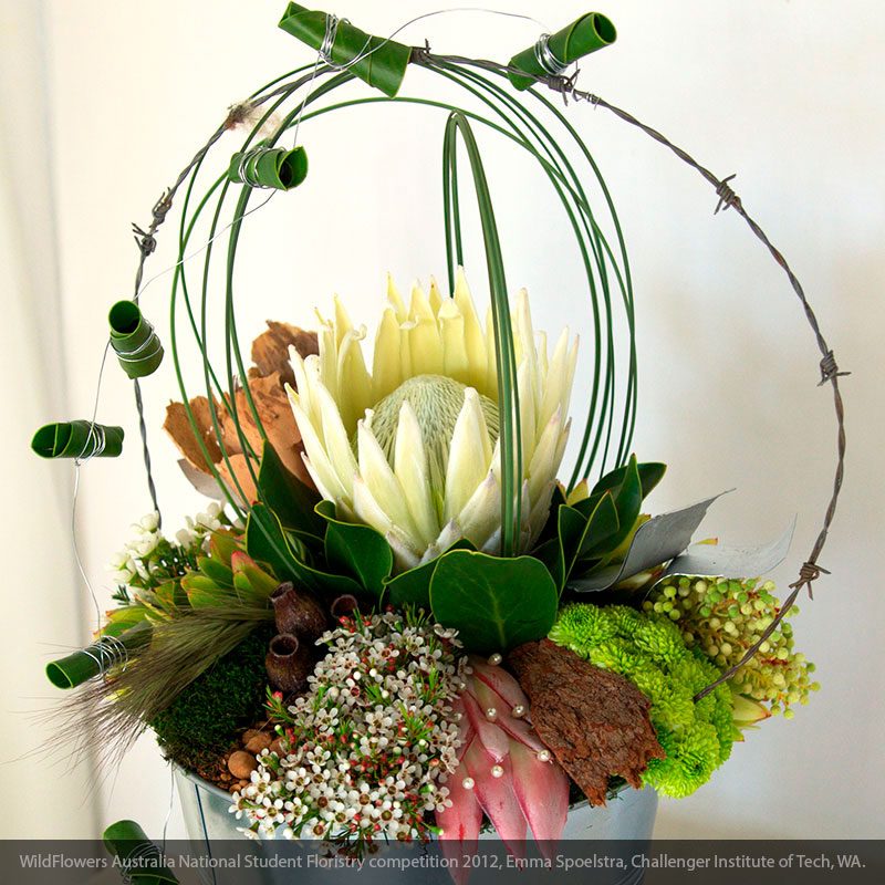 Steel grass and Waxflower in a rustic floral arrangement