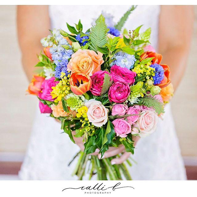 Umbrella Fern features in colourful spring themed bridal bouquet