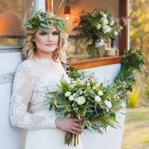 Bride holding bouquet featuring native Australian foliage