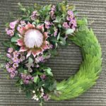 WREATH ~ Designer : Alice Stallworthy, Wildflowers Australia competition ~ Flowers & Foliage : waxflower, king protea, leucadendron, gum