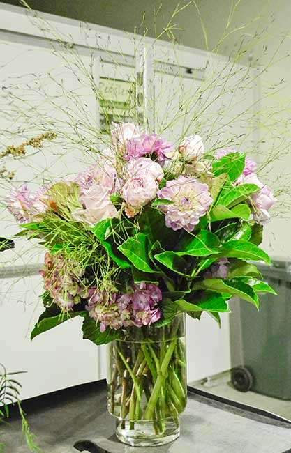 Emu Feather softens a large vase of dahlias and peonies. Hacienda Flowers
