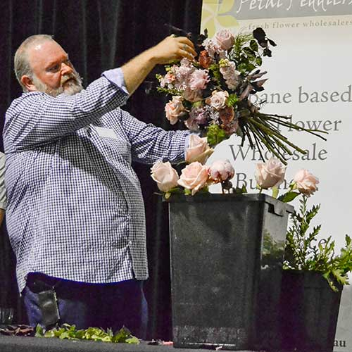 Brian of Perrots demonstrates how to construct a handtied bouquet