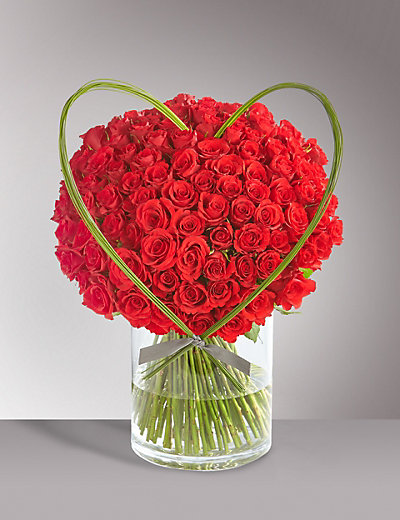 Red rose bouquet in vase with Flexi Grass heart