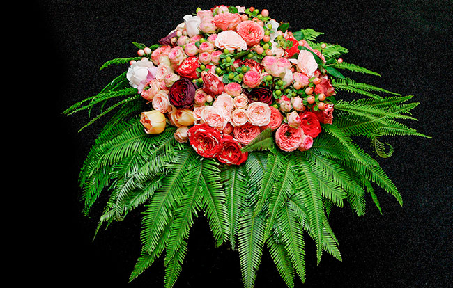 Floral arrangement using Umbrella Fern as a collar.