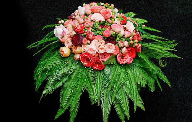 Floral arrangement using Umbrella Fern as a collar.
