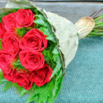 BOUQUET ~ classic red roses with Koala Fern™ and Umbrella Fern™ collar, lotus leaf wrap